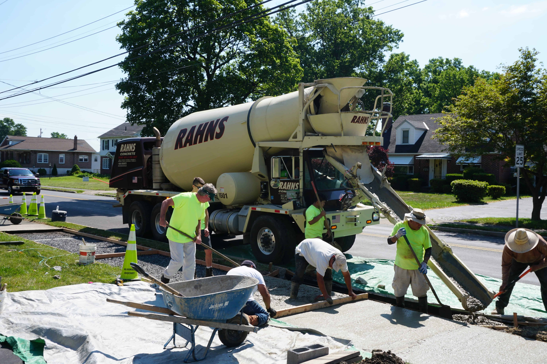 Picture of Rahns Concrete Mixer pouring concrete for sidewalk job