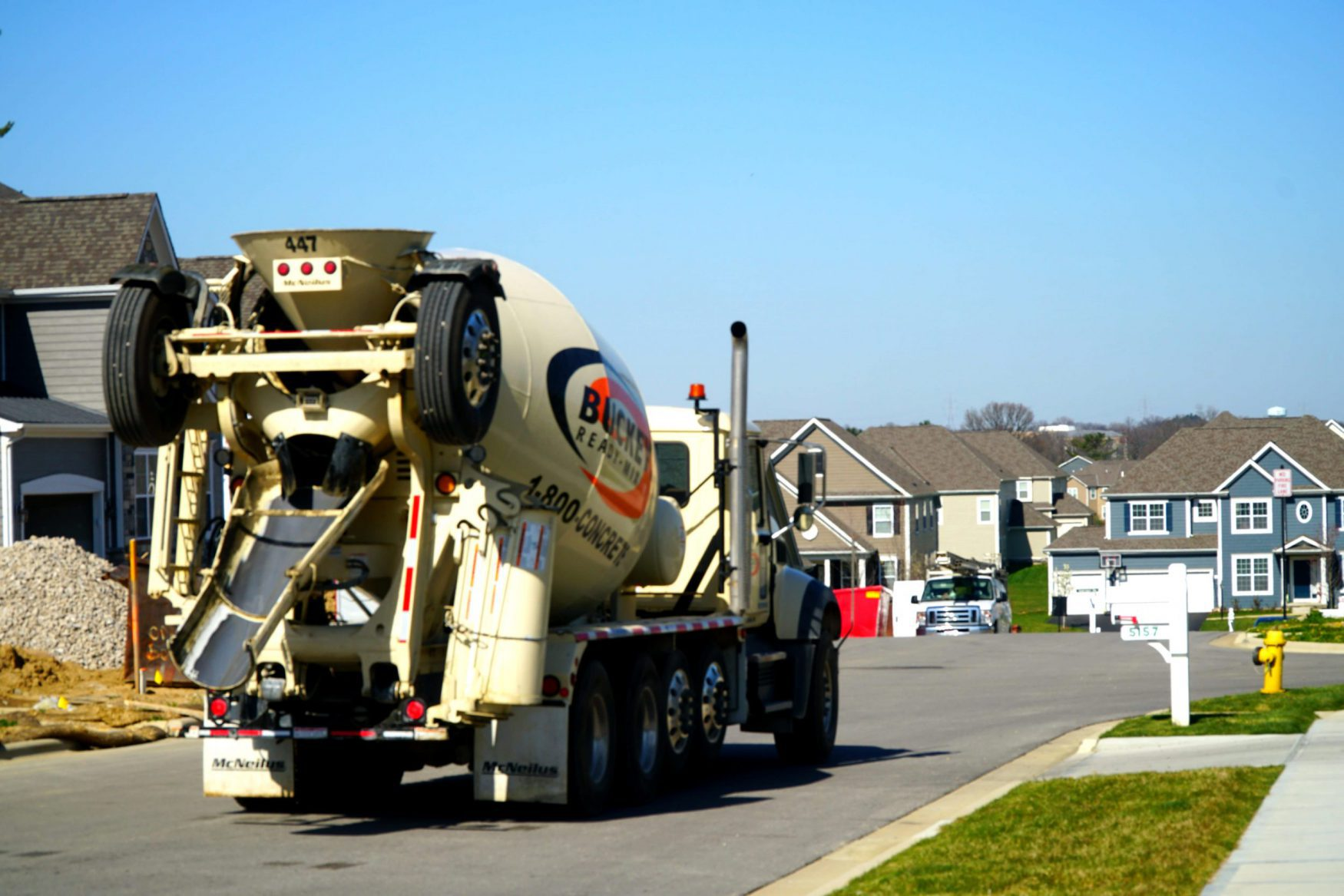 Image of Buckeye Ready Mix Truck delivering concrete to a new home in Westerville,OH - 1-800-CONCRETE